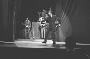 Bruce Forsyth closes the curtain on the Beatles first TV performance at London's Palladium circa 1963