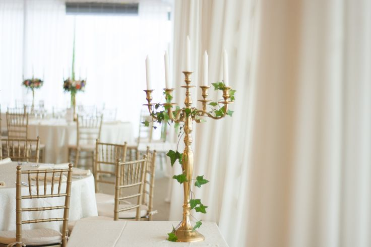 Gold candlestick decorated with ivy