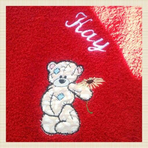 Appliqué teddy bear with embroidered name on a Bath Towel....