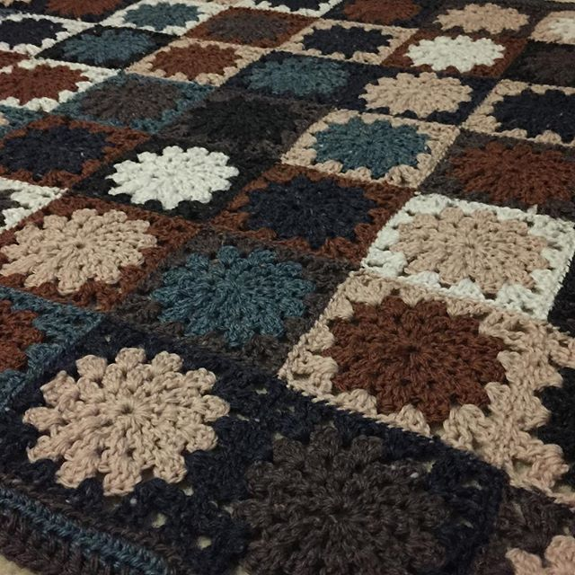 A lovely throw rug made for my lovely Nanna in neutral colours with a little blue-green touch. My first attempt at colours without a set pattern for arranging the colours. .  .  .  #aydamade #throwrug #bluegreen #brown #navy #cream #grey #handcrafted #crochet #wool #custommade #handmadegift #livingroomdecor #bedroomdecor #crochetersofinstagram #grannysquare