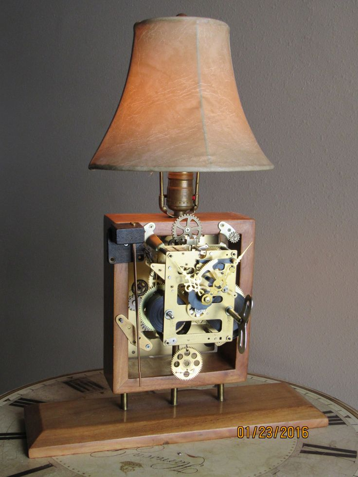 Eric is particularly proud of this one. This lamp is not only beautiful, the clockwork works. You can wind the main spring, the repurposed pendulum swings, the chimes sound, you can watch the gears wo
