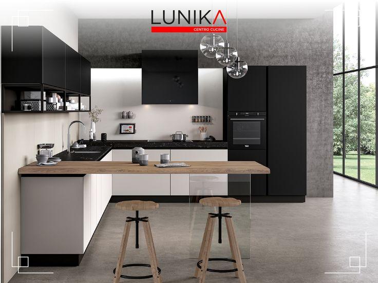 Cucina modello Glass in vetro opaco bianco e nero, con snack in legno che sembra sospeso grazie ad un supporto in vetro. Il blocco pensili è caratterizzato dall'inserto di elementi  a giorno in acciaio brunito industrial style.