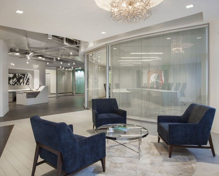 The Angled Reception Desk And Curvilinear Glass Conference