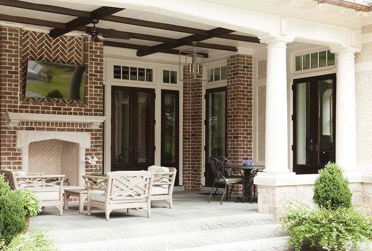 Brick Patio Fireplace - Home Designed by Frank Neely - Photography by Emily Followill