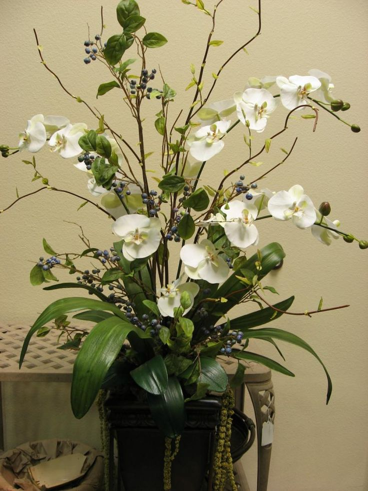 25 best ideas about contemporary flower arrangements on for Artificial leaves for decoration