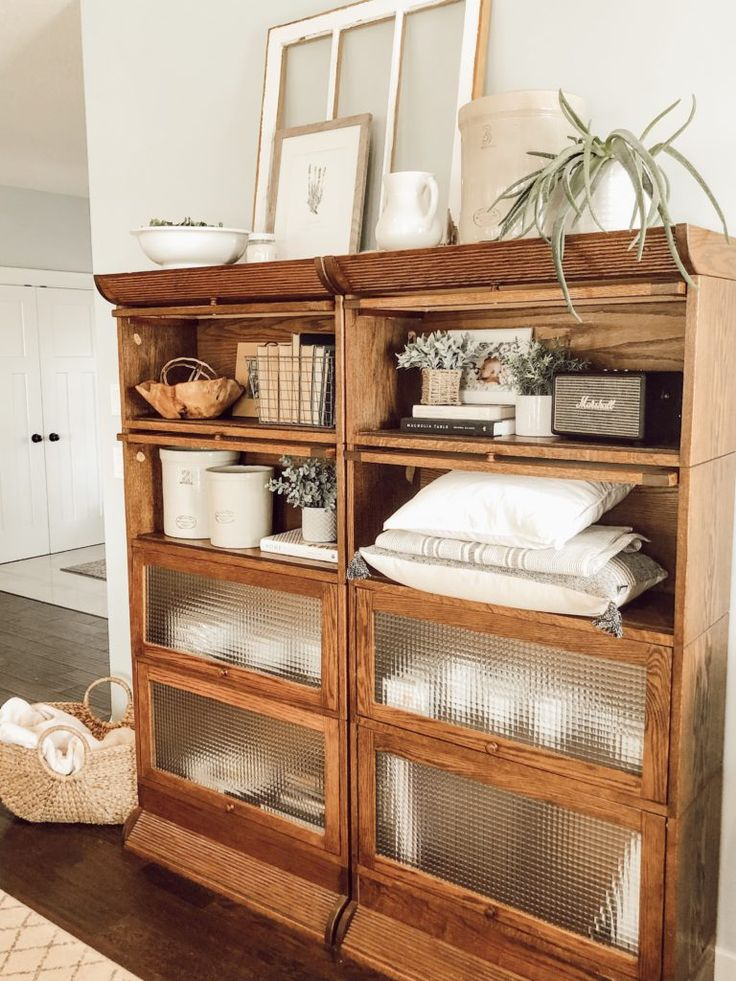 These lawyers bookcases are styled with vintage and modern items for a farmhouse style look. Shelf Styling With Vintage Decor – Valley + Birch #shel…