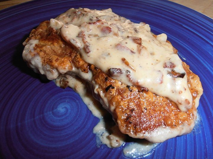 Pork Chops with Bacon Gravy  4 slices bacon, chopped 4 pork sirloin chops 1/2 C. chopped onion 1 C. flour plus 3 T. flour 1 tsp. each salt and pepper 2 C. milk 3 T. bacon grease or butter  In a large, heavy bottom skillet (I used an iron skillet) cook the chopped bacon over medium high heat for 2 minutes, add in the onions and continue to cook till bacon is crisp and onions begin to brown.  Remove with a slotted spoon to a bowl and set aside.  On a plate combine 1 C. flour, salt and pepper…