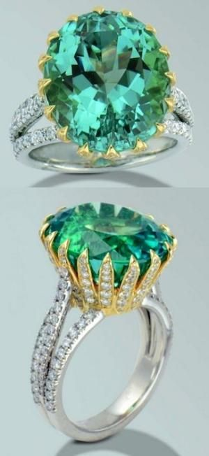 Electric green tourmaline, Platinum and 18 karat yellow gold ring with one oval, Sea foam Green Tourmaline and diamonds. Tourmaline weighing 15.80 carats and 166 round brilliant cut diamonds weighing 1.49 carats. by shawna