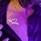 Small Heart White Ink UV Tattoo