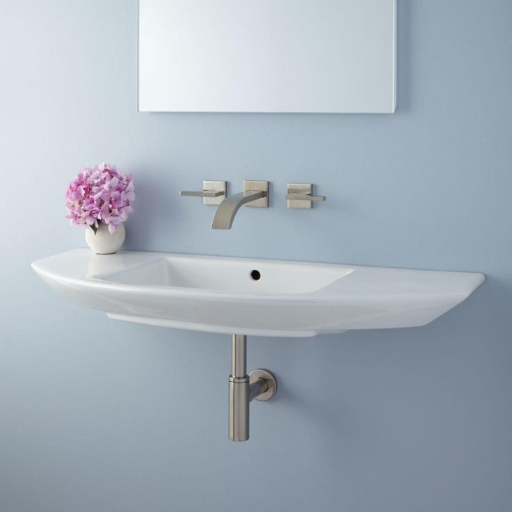 Wall – mounted narrow bathroom sinks.