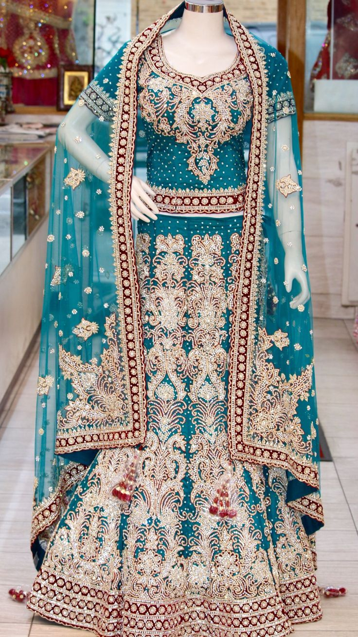 Teal and maroon bridal lehenga. This all over design is sure to make you the princess that you have dreamt of being. Come in and stop by  @ Bombay Bridal Boutique in Jackson Heights  718-426-0600