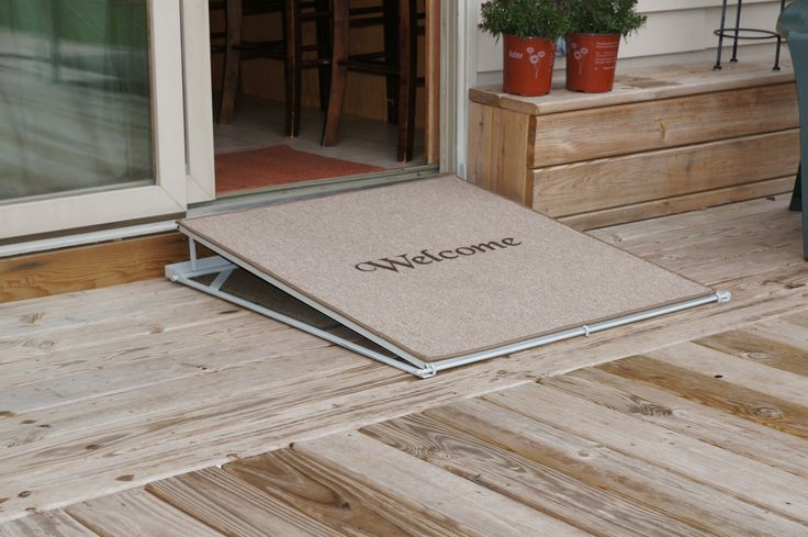 "Welcome Mat Ramp For structures with thresholds of 1"" to 8"", ConvertaStep also offers the ""Welcome Mat Ramp."" When not in use, the carpet covered ramp lies flat and serves as a door mat.  This ramp comes in a manual or a powered version that operates with a wireless remote."
