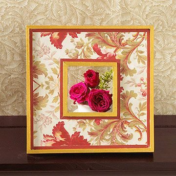 Give a discount frame a makeover by accenting its features with pretty paper. Make a template using scrap paper, trace the template on floral-pattern paper, cut out, and attach using spray adhesive. Glue strips of red paper over the floral-paper edges.