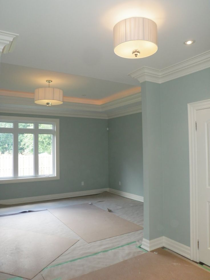 Paint color: Silver marlin benjamin moore. So pretty! love the crown molding and all the crisp white trim!