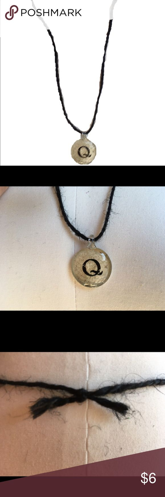 Handmade Black Twine Initial 'Q' Necklace Beautiful handmade black twine necklace featuring a silver-coated beige pendant with the initial 'Q' in the center. Approx. 13.5 inches, including pendant. Only one available. Handmade Jewelry Necklaces