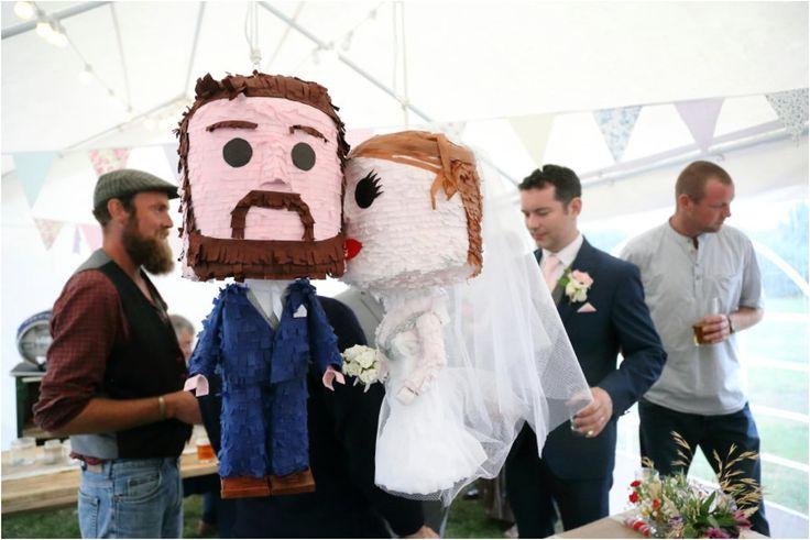 bride and groom pinata at rustic tipi wedding, suffolk