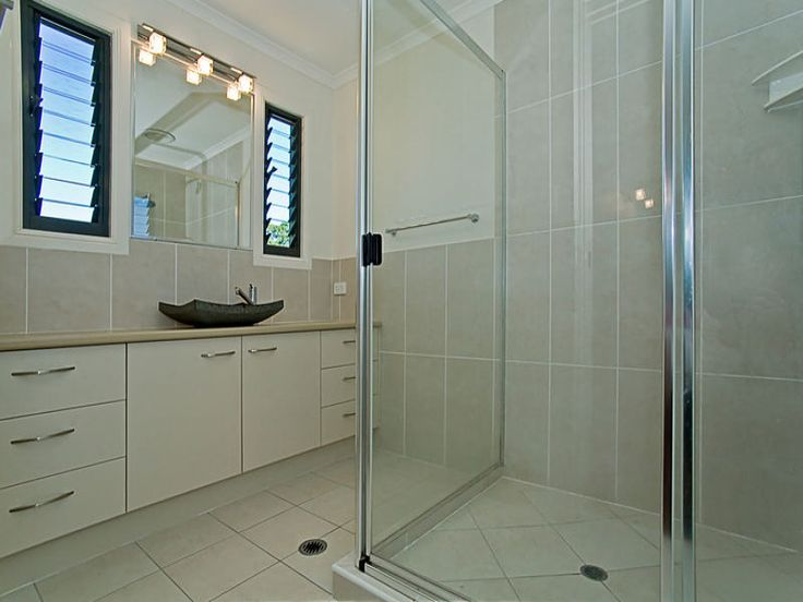 Beautiful yet understated Ensuite Bathroom with louvre windows + stone basin | Tru-Built Builders Queensland