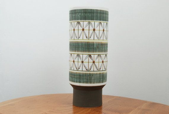 Rare stunning large mid-century Langley/Denby footed cylindrical vase by Glyn Colledge.  The Sycamore range was produced from 1963-1965, and features simple abstract designs. The colour pallet was limited to grey, green, brown and black giving them a very modern look. Sycamore was only produced for 2 years making it quite a rare range.  Dimensions approx: H. 30cms / W. 12cms