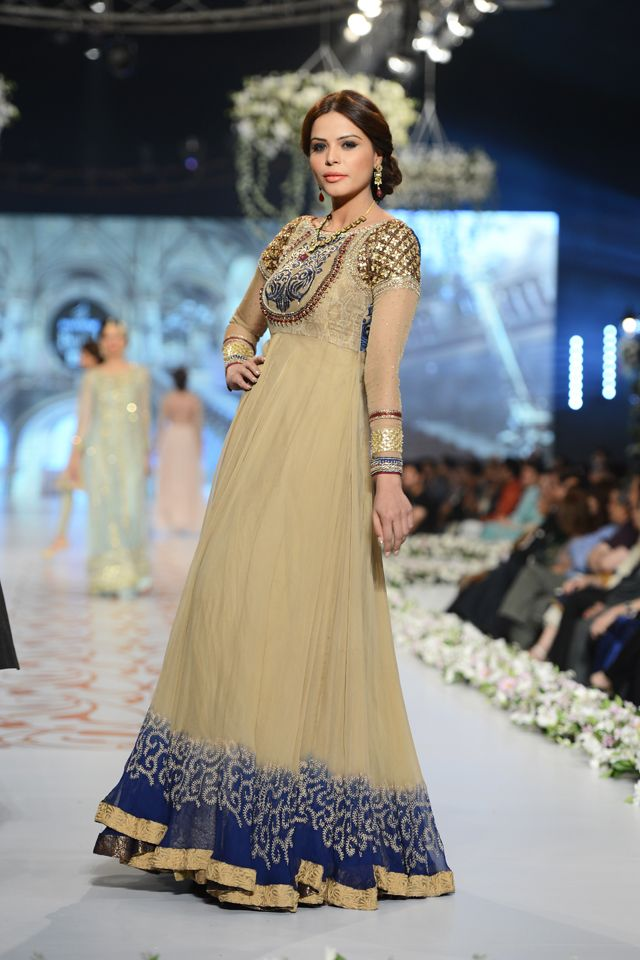 Model looks stunning in a beige and golden embroidered floor length #anarkali.