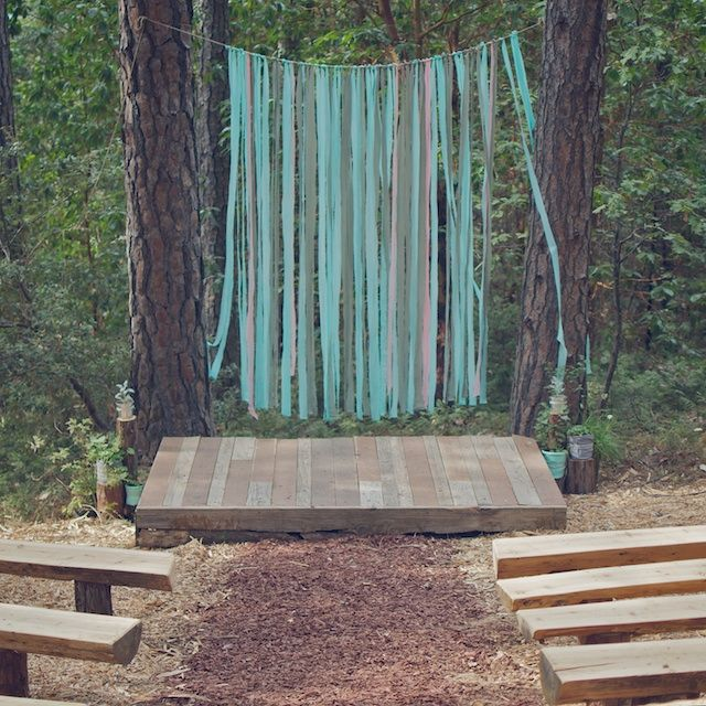 Outdoor wedding backdrop made from strips of fabric... sheets actually. Would be cute for any outdoor photot shoot!