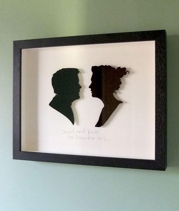 David and Kate. 3mm laser cut black silhouettes. Cream mount. Names/wedding date hand written. Custom hand made frame in black oak. 250mm high x 300mm wide x 30mm deep.