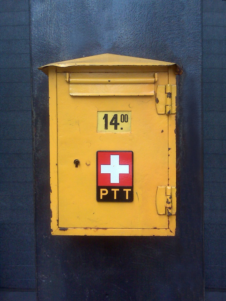 Official Swiss post office box attached to the facade of a ...