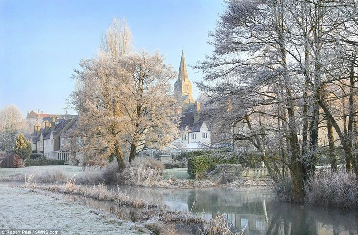 Wintry scene: The Wiltshire countryside had a beautiful covering of frost around Malmesbury and the River Avon yesterday