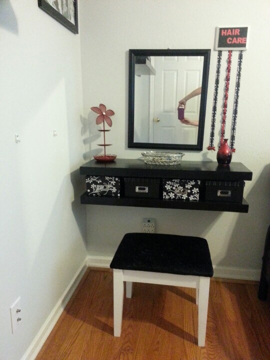 I made the floating shelves for this vanity, made the bow holder, reupholstered the stool, spray painted a lime green jewelry holder we already had, found a mirror at Goodwill, and photo boxes from Gordman's for $3 each. Total was only $51 including wood, paint, everything!