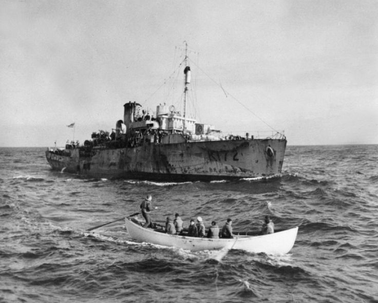 HMCS TRILLIUM rescuing survivors from three ships sunk by U-606 February 1943 in the north Atlantic.