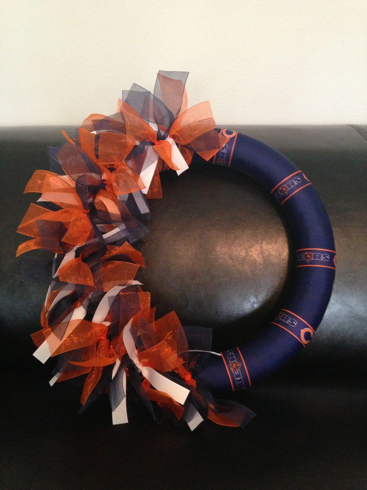 "Chicago Bears NFL Ribbon Wreath:   1 - Wrap14"" styrofoam wreath tightly in the ribbon of your choice securing with pins.  2 - Cut ribbon for tying with wood burning tool (this will prevent fraying!); each piece should measure approx 14"" .... be sure to tie very close together to the point of over lapping. Knots should face front of wreath.  3 - Cut ""team"" ribbon in 7"" pieces and secure to wreath with pins.   Easy peasy."