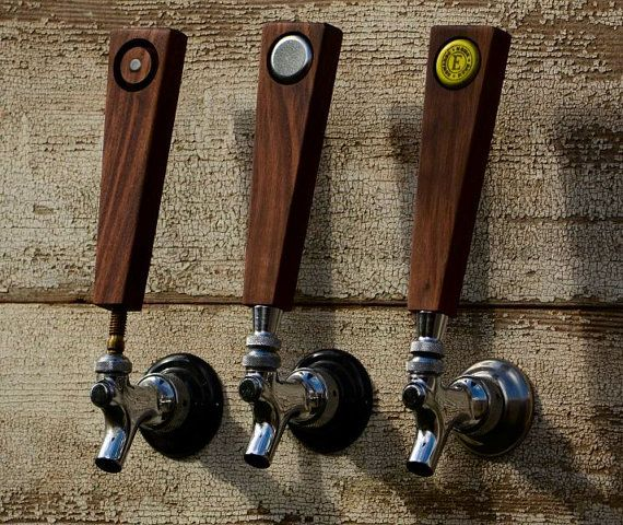 I love this idea. Maybe with metal-stamped badges for regular on-tap beers? (Must learn metalworking.)  CAPHANDLES.COM - Personalized Beer Tap Handle of Solid Walnut with your bottle cap as ID Tag