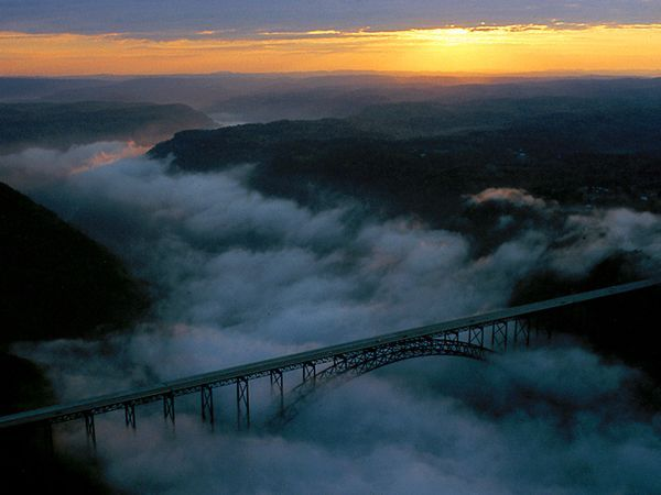 """West Virginia's New River Gorge Bridge was the world's longest steel-arch bridge (Shanghai's Lupu Bridge took the title in 2003). It opens to pedestrians once each year on """"Bridge Day."""""""