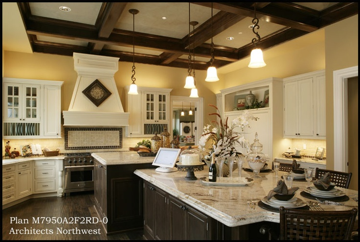 Another cool kitchen -- I like the butter colored walls, exposed beams, and mix of white and dark cabinetry