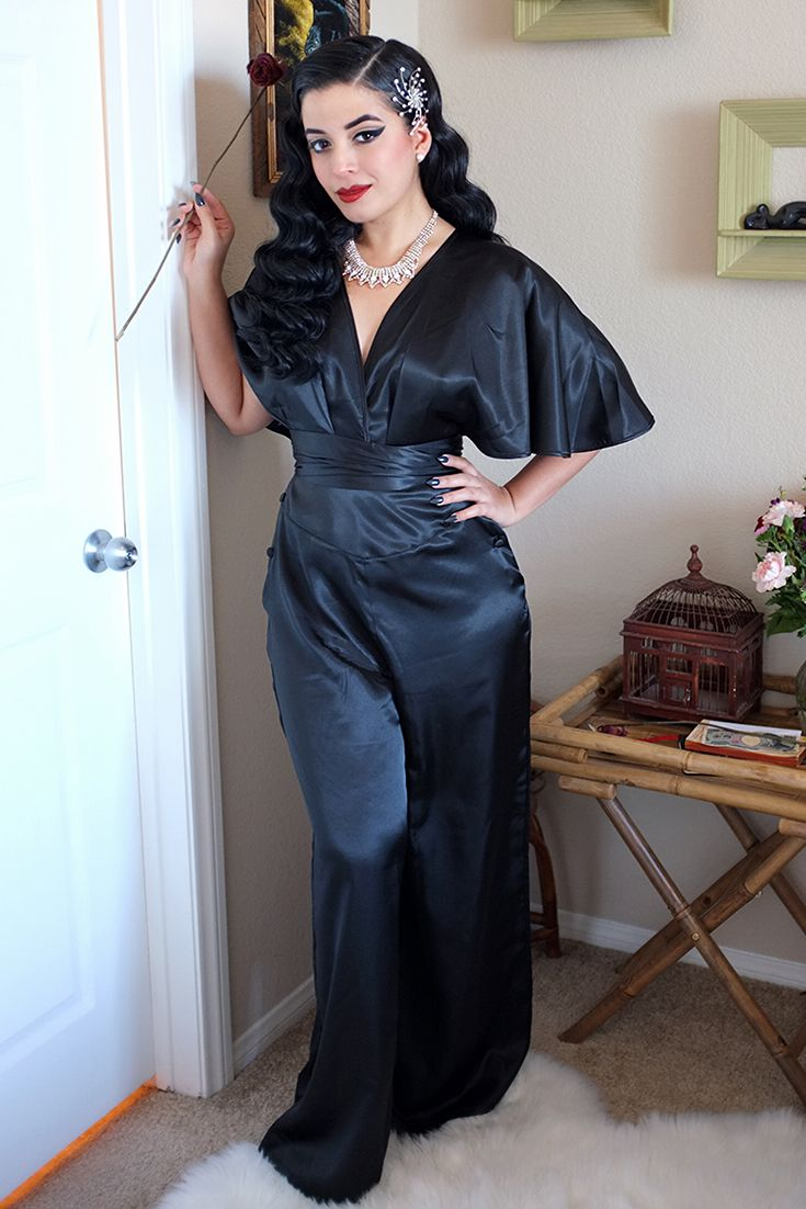 Archetypal 1930s Elegance by Vintage Vandal. The gorgeous Jasmin has been playing around with our 1930s Lounging Pyjamas in Black Satin! Here she's styled them as a jumpsuit with beautiful vintage accessories and her trademark winged eyeliner for a sleek, chic, luxurious look