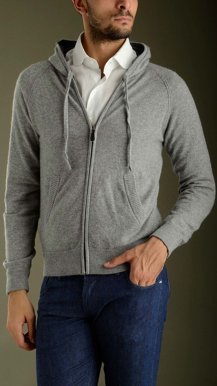 Hooded cashmere jumper in grey featuring long sleeves, contrast hood lined, two seam pockets, zip fastening,  elasticized fisherman's rib detailing neck, cuffs and bottom, regular fit, 100% cashmere.