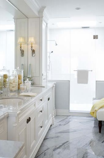Bathrooms White Bathroom Cabinets Mirror Chrome Sconces Marble Countertops Marble Tiles Floors Shower Crown Molding