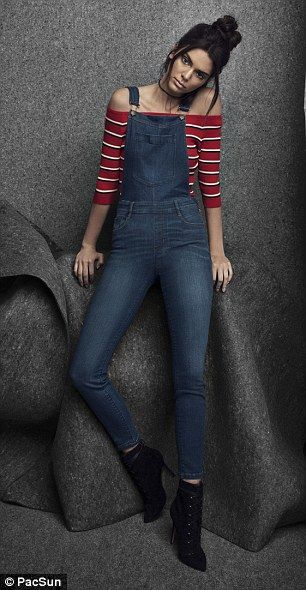 Modern fit: Kendall can be seen modeling an off-the-shoulder top and a pair of form-fittin...