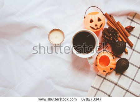 Flat lay of autumn and thanksgiving arrangement style with halloween pumpkin on white sheet blanket background