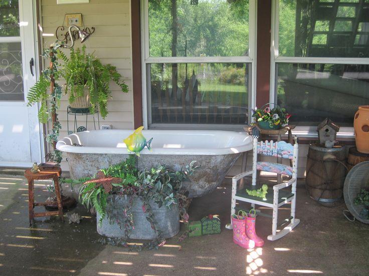 Old claw foot bathtub turned into goldfish pond on back for Bathtub fish pond