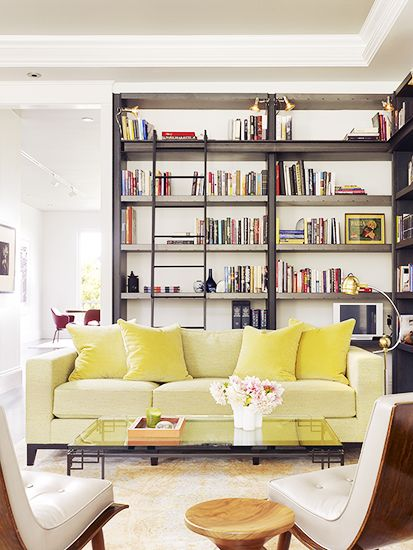 modern chartreuse sofa, wooden stool, industrial built-in bookcase, library ladder // living rooms // libraries: Built In Bookcases, Wooden Stools, Modern Chartreuse, Libraries Ladder, Living Rooms Libraries, Yellow Sofa, Chloe Warner, Chartreuse Sofas, Library Ladder