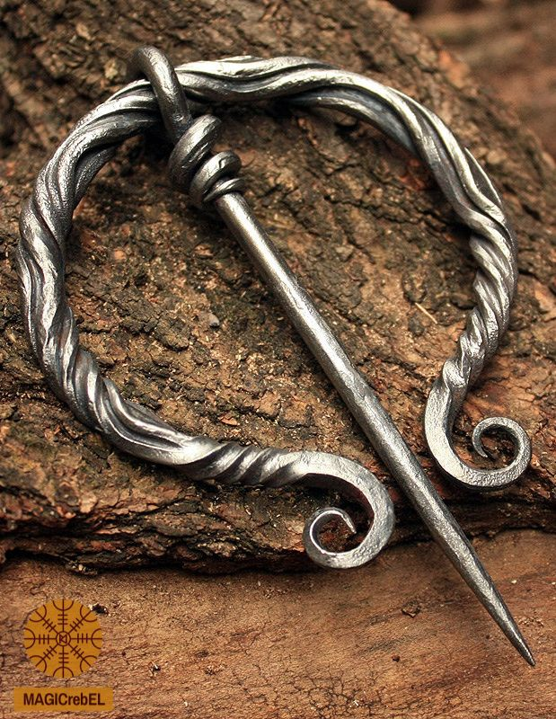 """This is a forged iron Viking-Era Medieval Nordic Renaissance style fibula pin brooch. The fibula can be used as part of a reenactment costume.  Fibula width size is 3.15"""" inches or 80 mm, pin length is 4.5"""" inches or 118 mm. Fibula is coated by a water resistant finish to protect it from rusting.  #magicrebel #forged #iron #fibula #pin #viking #medieval #nordic #brooch #costume #reenactment #larp #jewelry"""