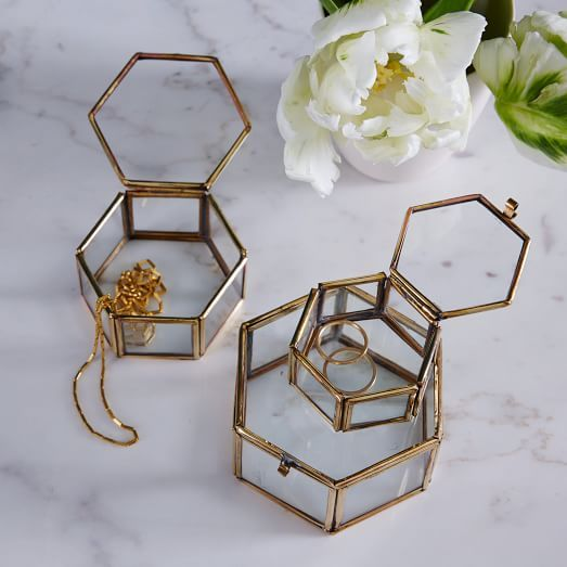 Lovingly displayed. With glass interiors that are perfect for keeping accessories organized, this set of Nesting Trinket Boxes add charm to dressers, shelves and vanities. In three sizes, they can be nested together or displayed separately.