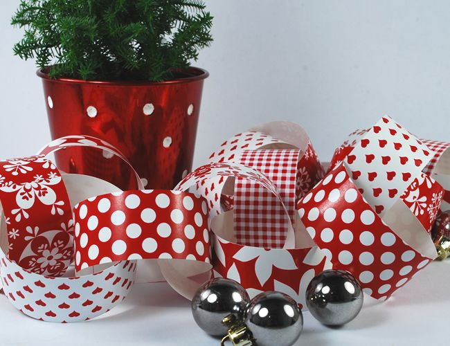 A Christmas paper chain. Crimson & white paper designs from The Colour Collection.