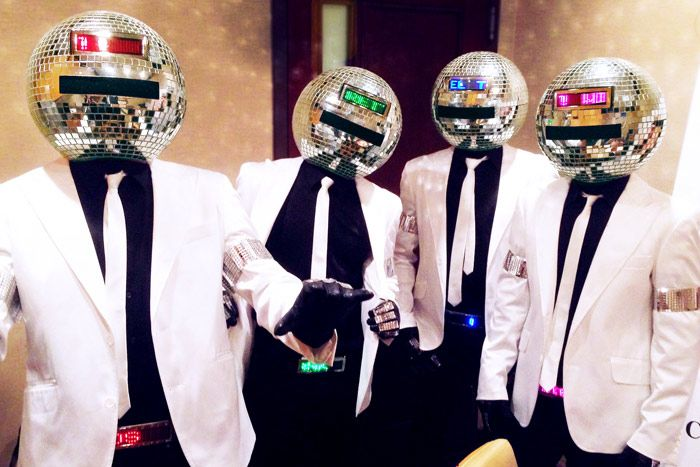 """""""Electric Disco Starz"""" from Tryon Entertainment involves a four-member crew wearing sleek suits and disco-ball-shaped heads with LED scrolls that can be customized to display a brand message or event name. The squad of performers can act as greeters or interact with the crowd during an event, as it has done annually since 2011 at the Allstate Life Insurance New York 13.1 Marathon."""