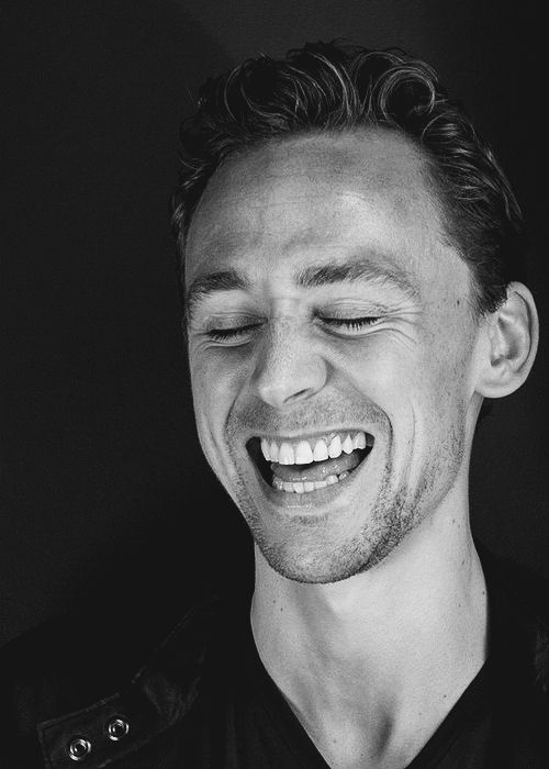 """Tom Hiddleston's smile - quite possibly the most contagious one in the entire world...it's so beautiful when he smiles. I know some people say that men shouldn't be described as """"beautiful"""" but it doesn't mean girlish or frilly. It means breathtaking and heart pleasing. We call scenery beautiful. Thus, this man is beautiful."""