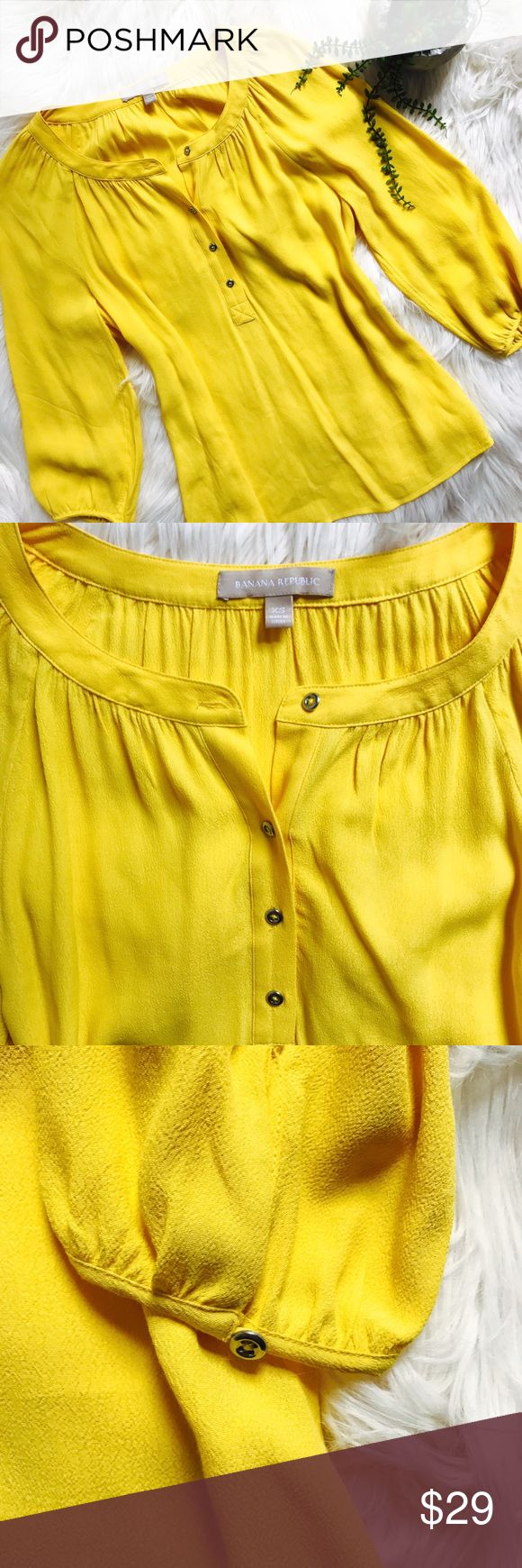 "[Banana Republic] Bright Yellow Top with Buttons This bright yellow loose, flowy top is in excellent, like new condition. It is a perfect addition to bright your wardrobe for spring! Selling because it does not fit me. MEASUREMENTS: chest (laying flat) 19.5"", length 24"" Banana Republic Tops Blouses"