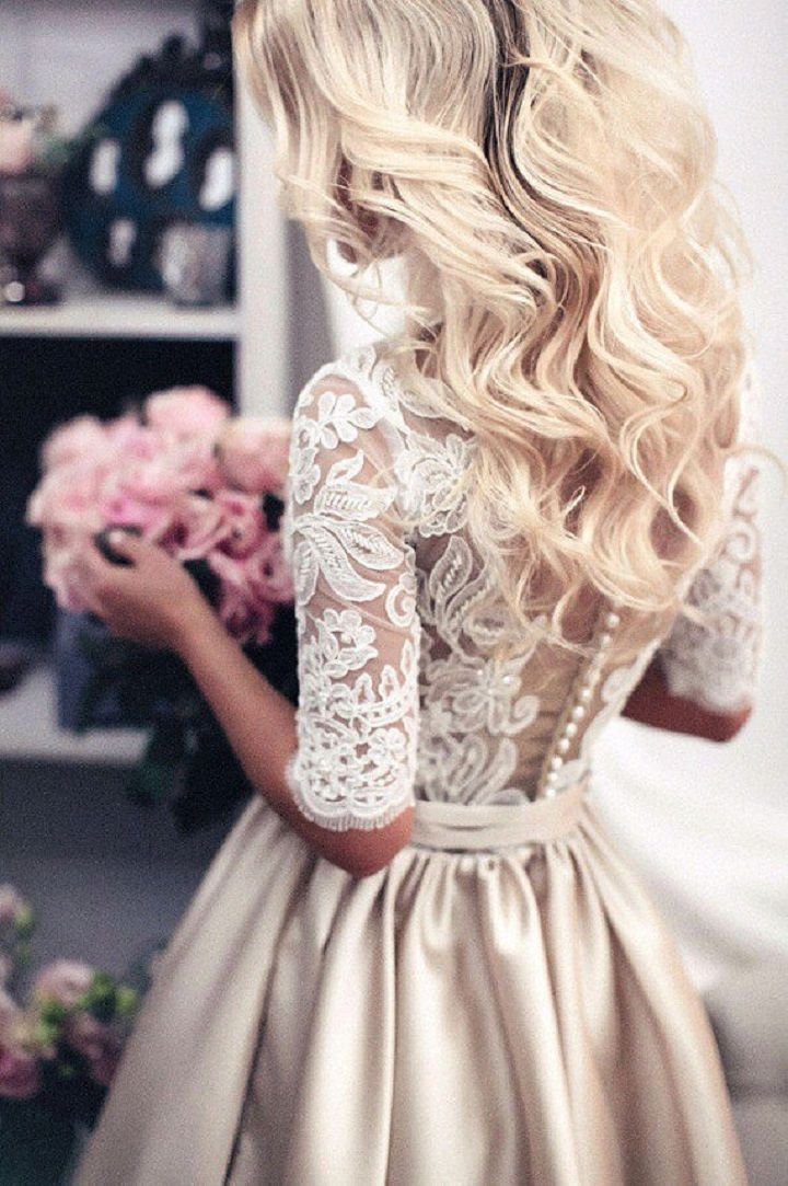 Beautiful tea length sleeve lace wedding dress.