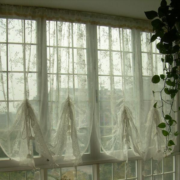 Rod pocket ivory lace curtain has attached valance for a finished look, And rings on the back so you can gather the curtain to different heights. Description from ebay.com. I searched for this on bing.com/images