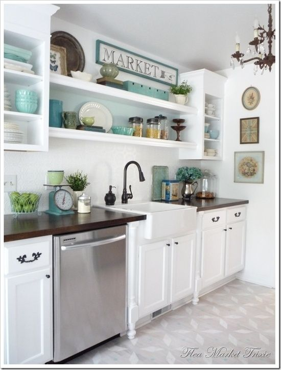 Love the color scheme, maybe paint the back of the glass cabinets a color or do a blue/green glass subway tile backsplash.