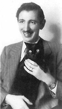 Armenian-American composer Alan Hovhaness and his cat, Rajah Mahatma Hoyden.